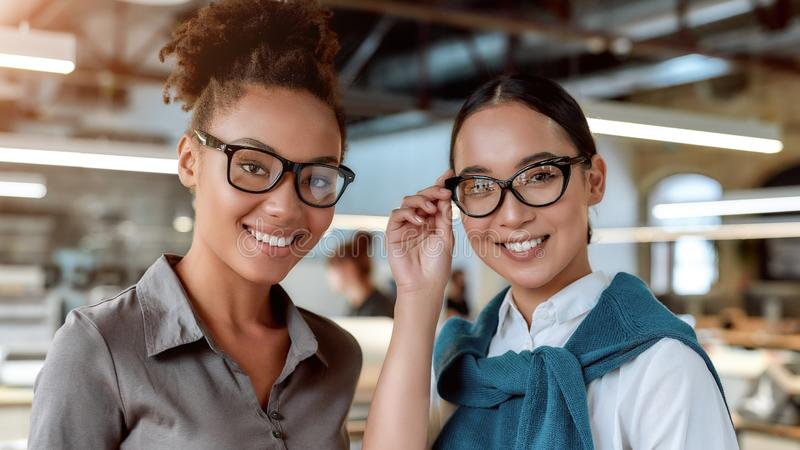 Your suggestions are always welcome. Female co-workers posing in office stock photography