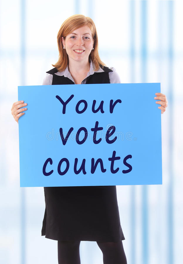 Your vote counts. Young beauty business woman hold paper thank your vote counts text on it royalty free stock images