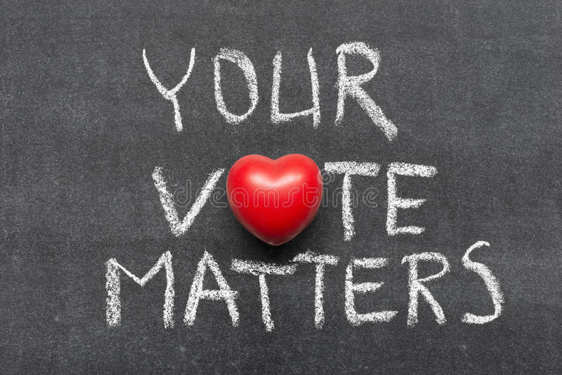 Your vote matters. Phrase handwritten on blackboard with heart symbol instead of O royalty free stock photography