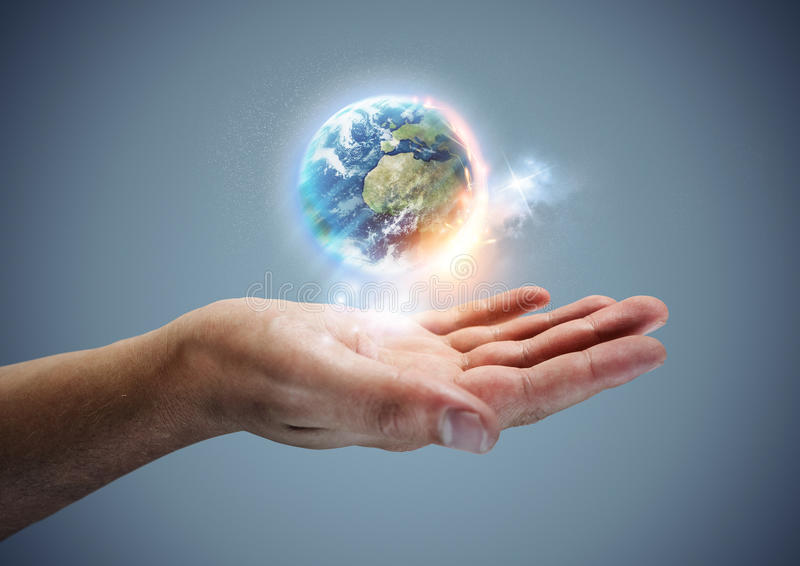 Your World. The planet earth hovering in a hand stock images