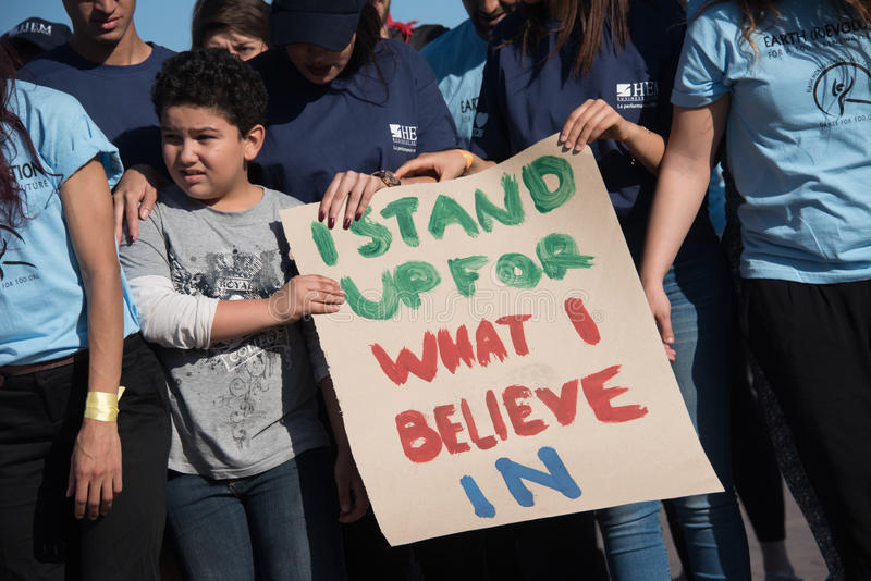 Youth activists protest. Young activists at the COP22 UN climate conference hold a sign reading `I Stand Up For What I Believe In` at a demonstration in Jemaa el stock photo
