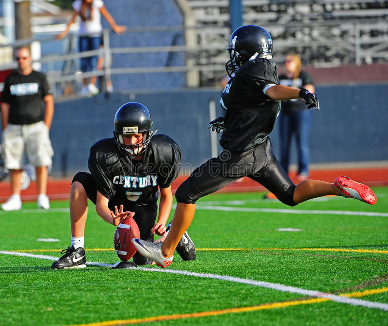 Youth American Football the punt royalty free stock photo