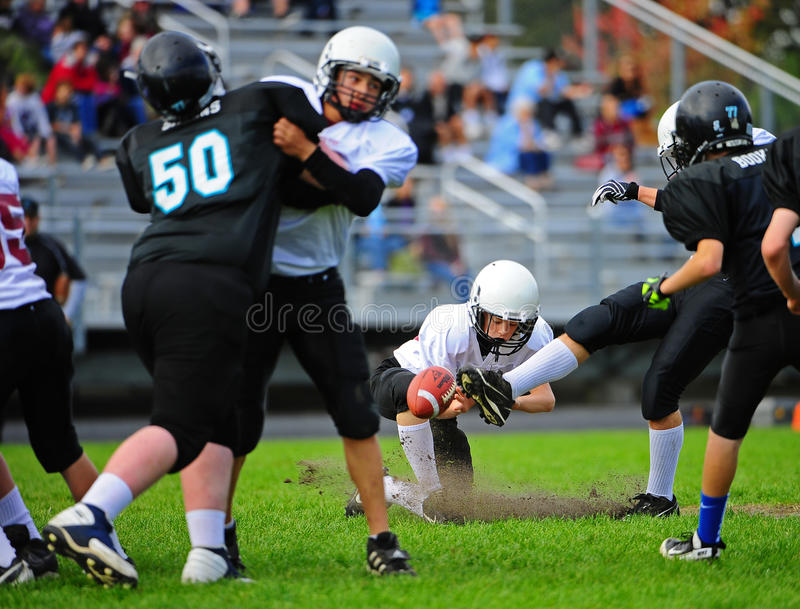 Youth American Football Punt Editorial Image