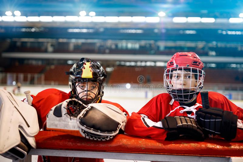 Youth boys hockey players. In ice stock photo