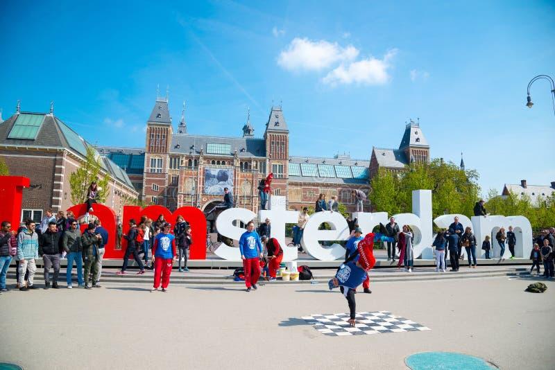 Youth break dancing on city streets. Street festival breakdance. Amsterdam, Netherlands. Amsterdam, Netherlands - April 20, 2017: Youth break dancing on city stock photography