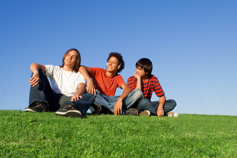 Youth chilling out. Group of youth chilling out, listening to music royalty free stock image