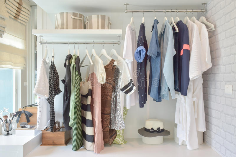 Youth cloths hanging in open wardrobe in bedroom stock photo