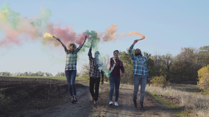 Youth with colored smoke grenades royalty free stock images