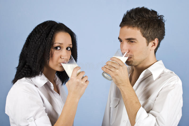 Youth couple drinking milk