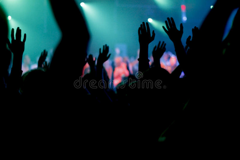 Group Crowd shot of Youth dance to Rock band/ Hip-Hop group/ Rave. Youth dance to a Hip-Hop group performance, Rock band performance. Hands are raised and moods royalty free stock images