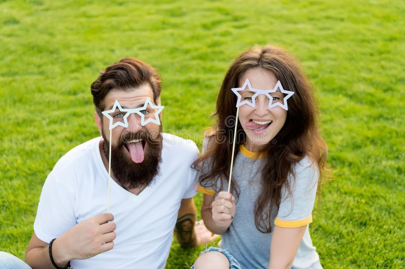 Youth day. Summer entertainment. Emotional people. Couple dating. Carefree couple having fun green lawn. Couple in love stock images