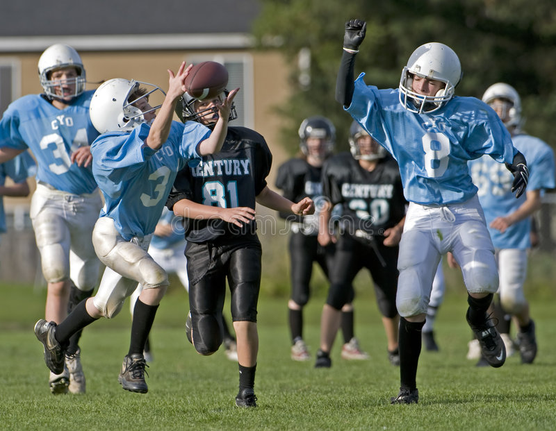 Download Youth Football editorial stock photo. Image of jump, pass - 6860148