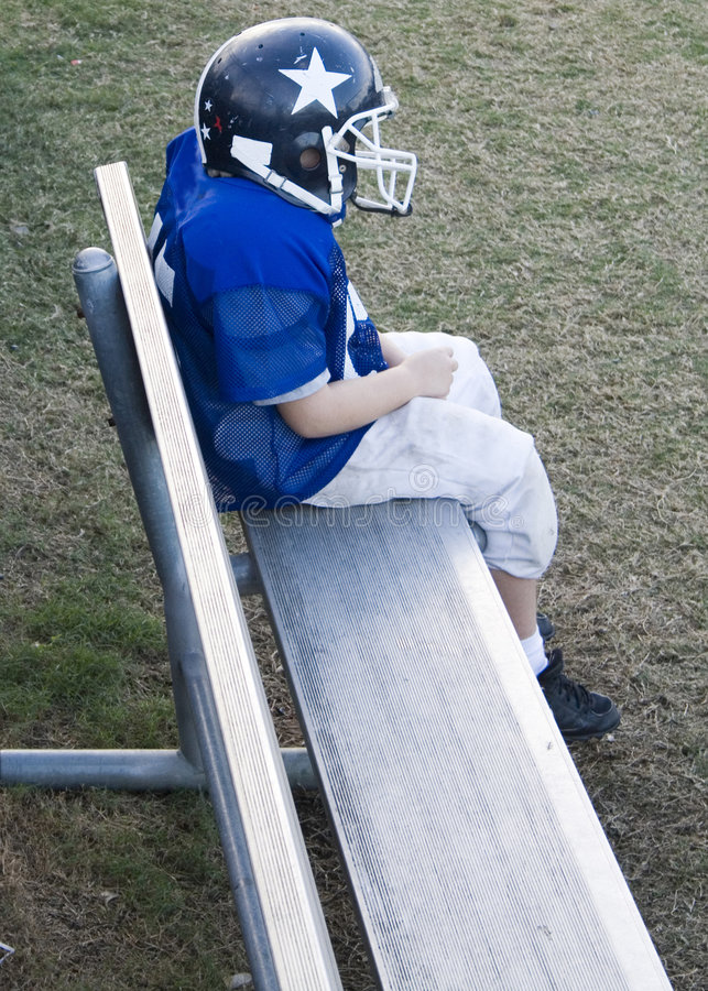 Download Youth Football Player Alone On The Bench Stock Image - Image: 3732687