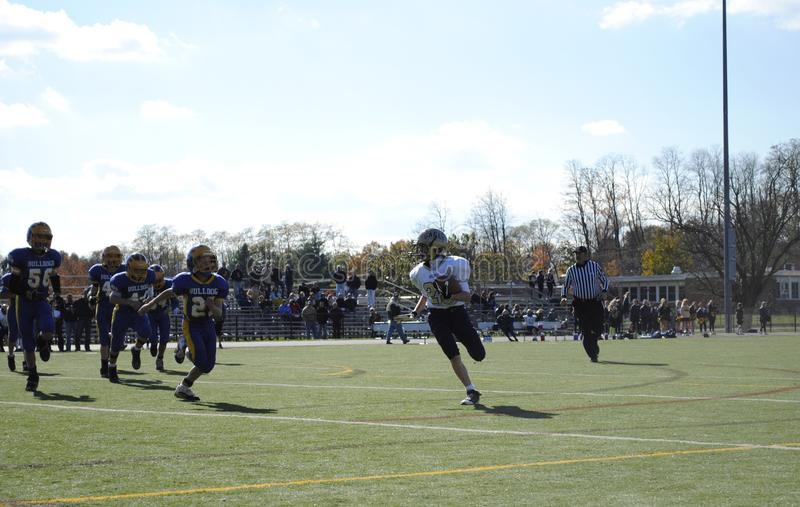 Youth football players running a play royalty free stock images