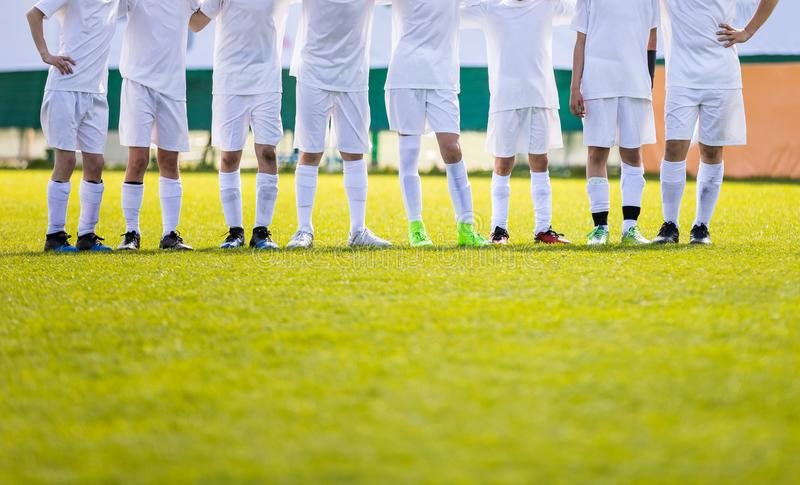 Youth Football Team. Young Soccer Players Standing in Row. Boys Standing Together During Penalty Shots. Boys in White Soccer Jersey Shirts royalty free stock image