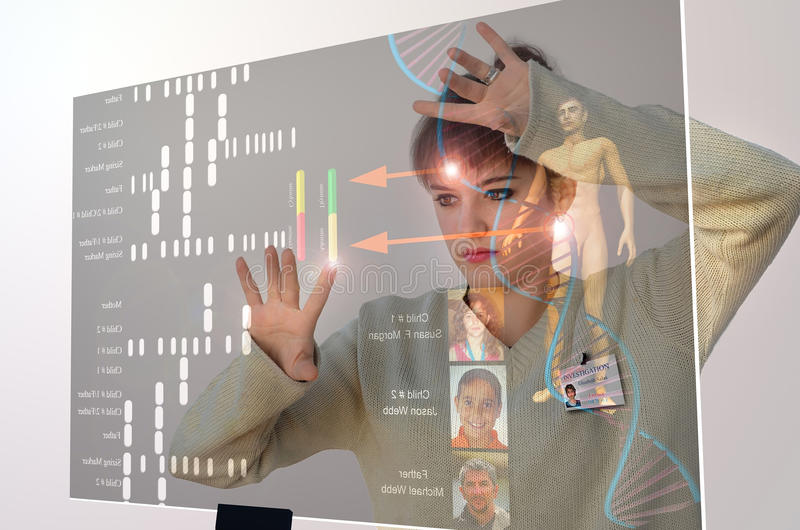Youth for the future. A young woman faces a transparent modern computer screen, working on DNA research. A concept presentation of the future generations of