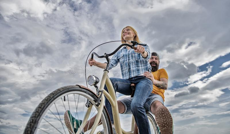 Youth have fun riding bike sky background. Enjoy summer holidays vacation riding bike. Couple in love happy cheerful. Enjoy cycling together. Happy moments stock photo