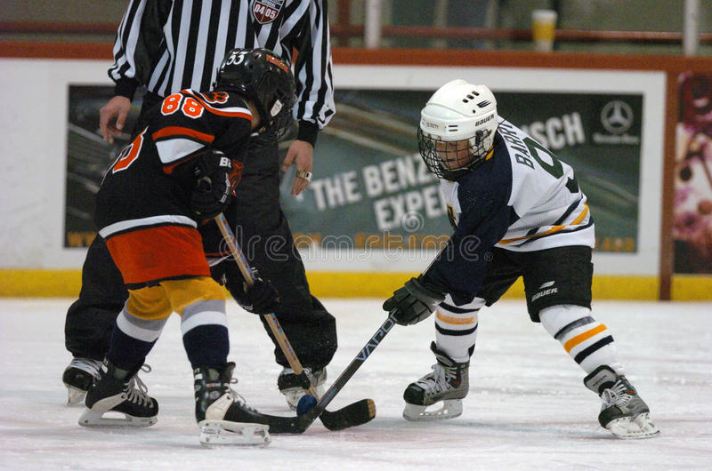 Youth Hockey Game With A Faceoff With Kids royalty free stock images