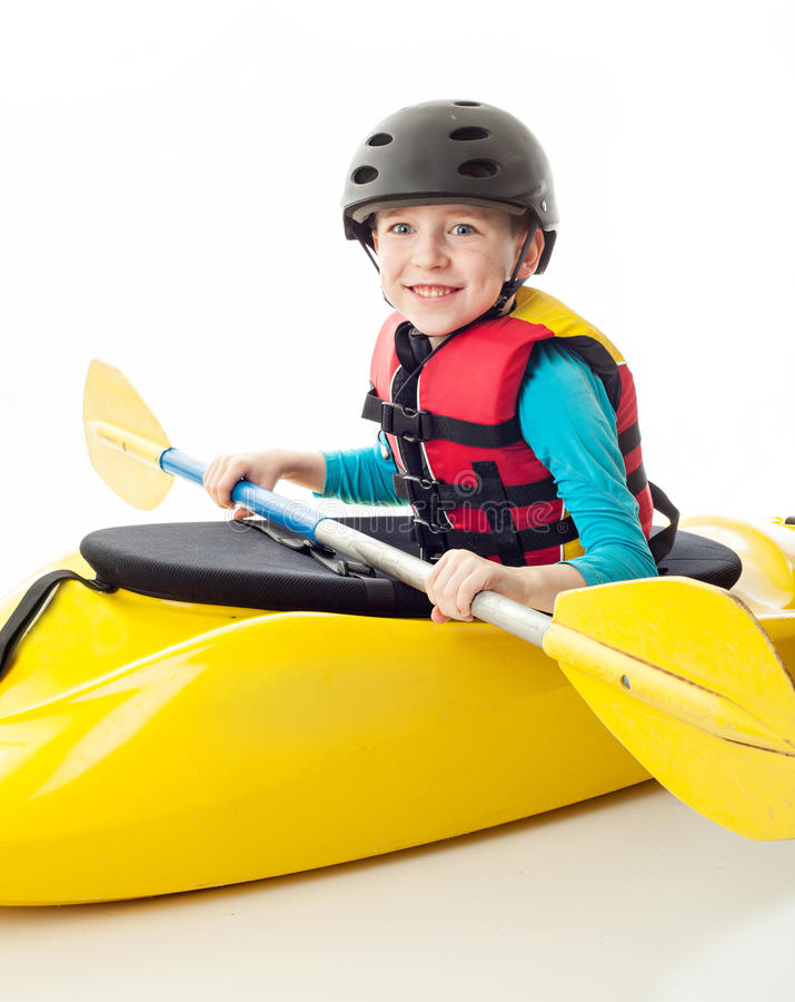 Youth Kayaker. Youth kayak paddler portrait in the studio, sitting in his kayak stock images