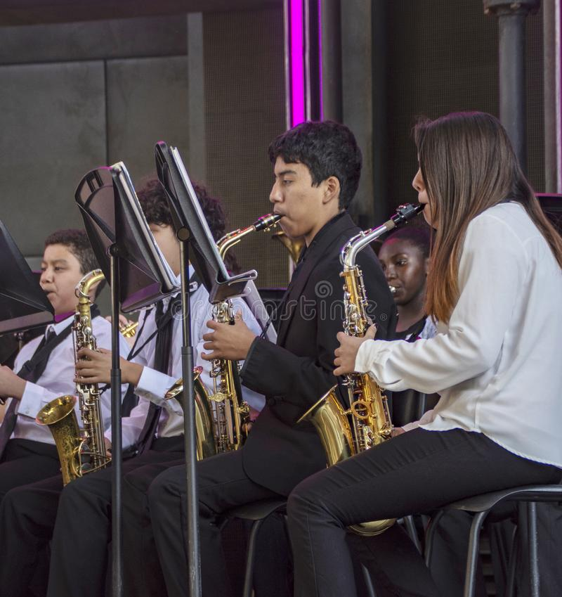 Youth perform on saxaphones in the orchestra Band at Disney`s California Adventure stock photos