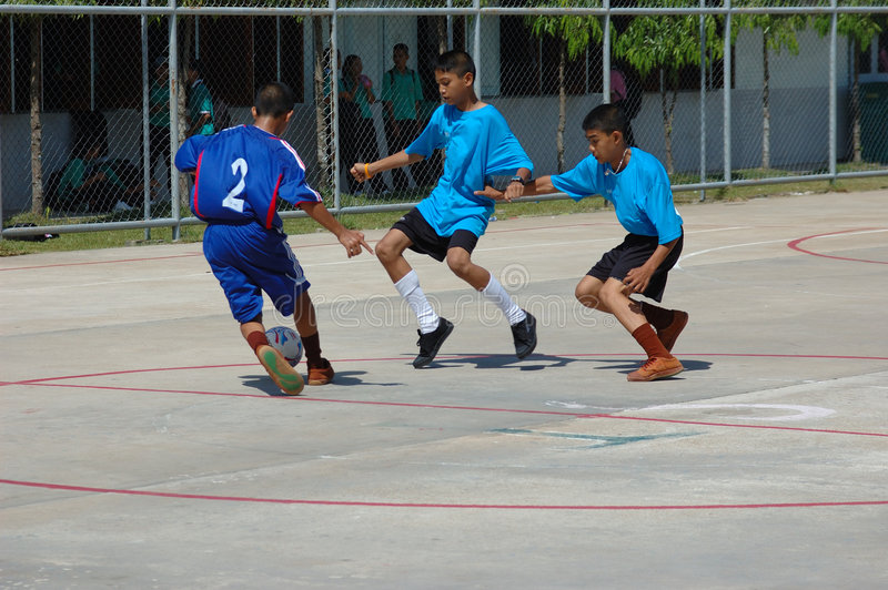 Youth Soccer Game in Thailand stock photos