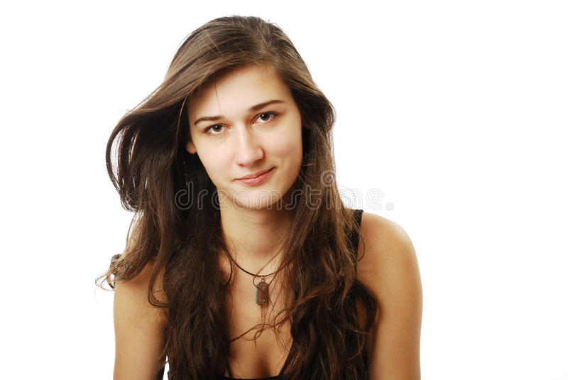 Youth woman with derisive look. Youth woman is somewhat smiling. Her derisive eyes are looking at the camera. Dark long hairs are spread over the shoulders. Copy royalty free stock images