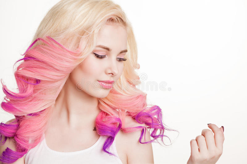 Youth women with colored curly hair on the white background. Beauty. Isolated. Studio. Gradient. Copy-space. Youth woman with colored curly hair on the white royalty free stock image