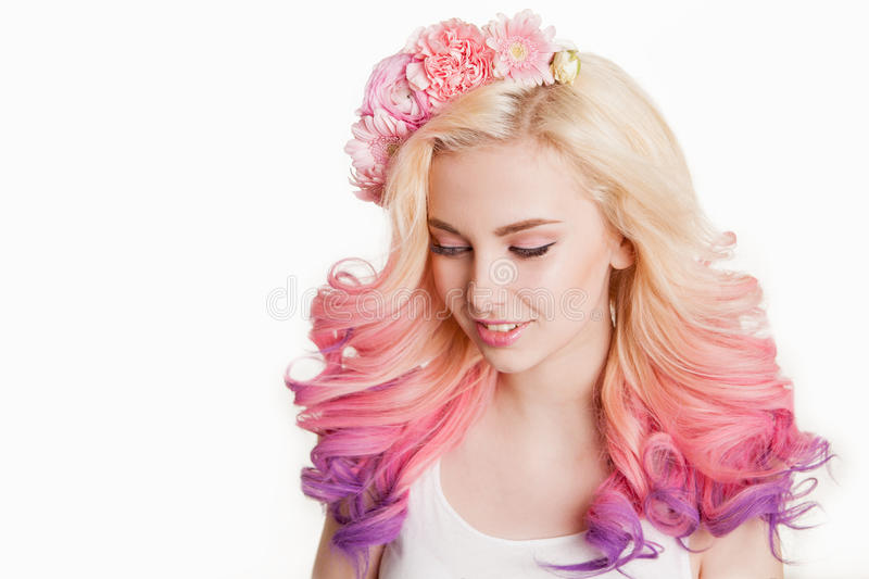 Youth women with colored hair smiling. Flowers in her . Studio, isolated, white background. Concept spring, summer. look. Youth woman with colored hair smiling royalty free stock photography