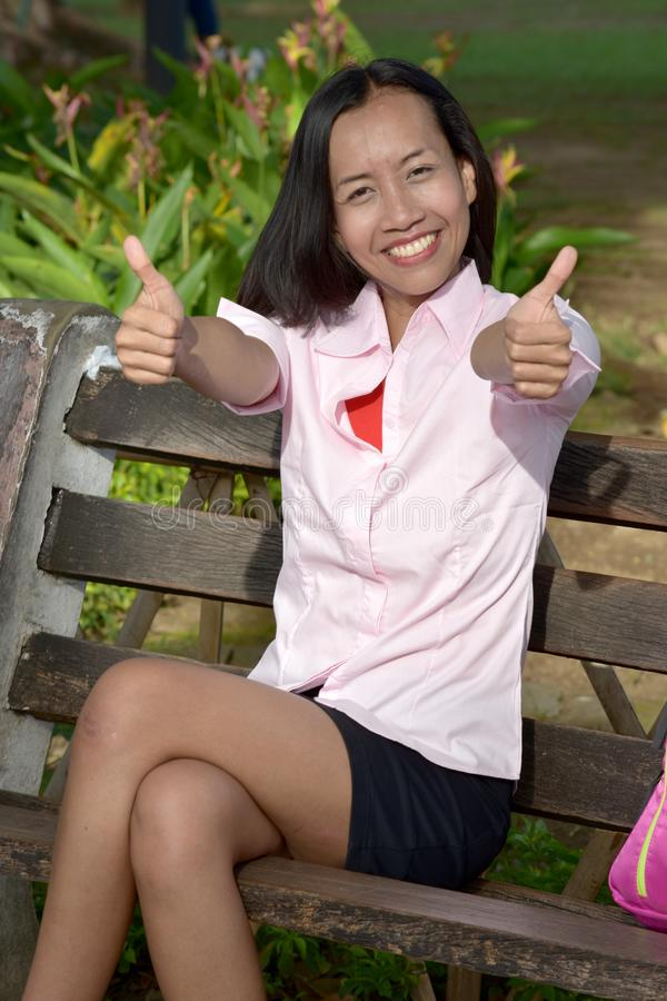 Youthful Asian Female And Happiness. An attractive and asian person royalty free stock photography