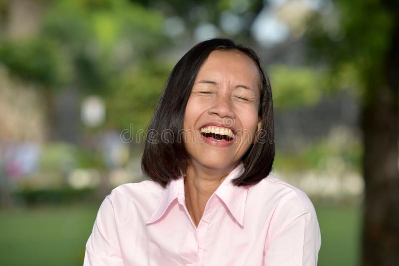 Youthful Asian Female Laughing. An attractive and asian person stock images