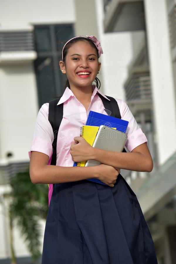 Youthful Asian Female Student Smiling With Notebooks stock photos