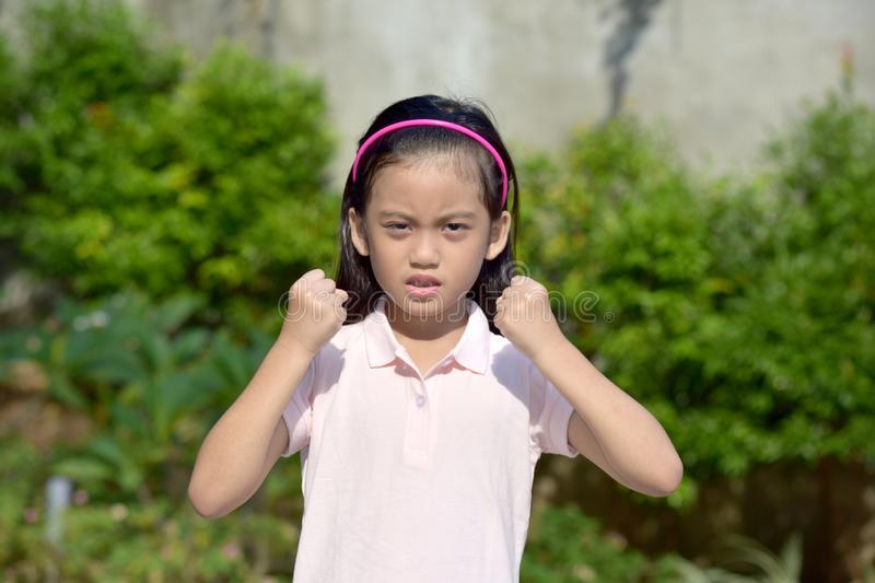 Youthful Asian Girl And Anger. An attractive and asian person stock photos
