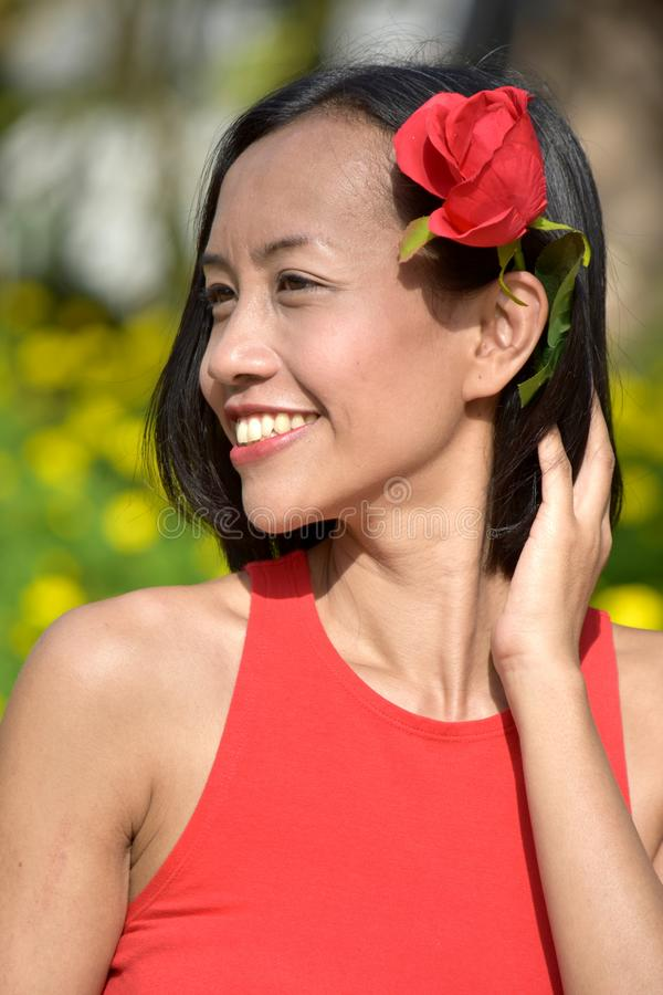 Youthful Diverse Adult Female And Happiness With A Rose. An attractive and asian person stock images