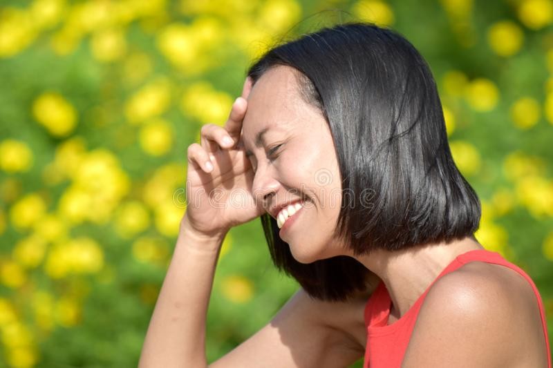 Youthful Diverse Female Laughing. An attractive and asian person stock photos