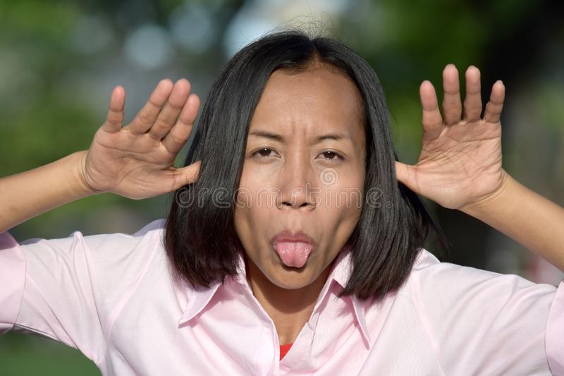 Youthful Filipina Woman Making Funny Faces. An attractive and asian person royalty free stock photos