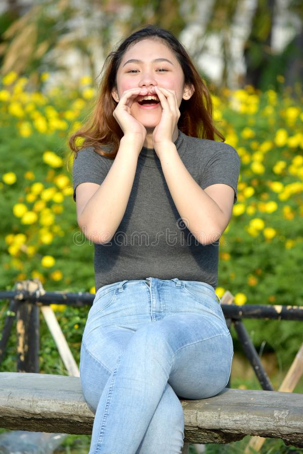 Youthful Filipina Woman Shouting. An attractive and asian person stock images