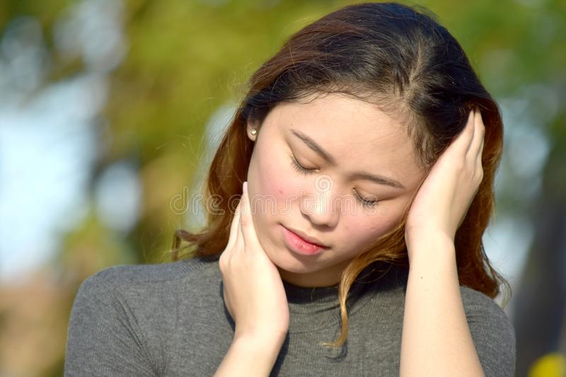 Youthful Minority Female And Depression. An attractive and asian person royalty free stock photo