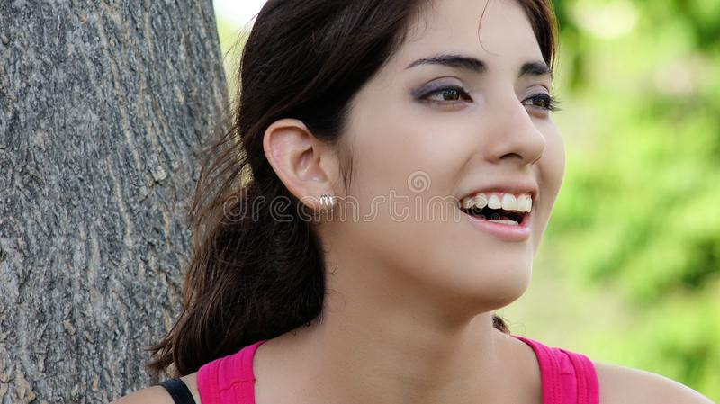 Youthful Minority Female Laughing. A pretty young Peruvian adult female royalty free stock photo