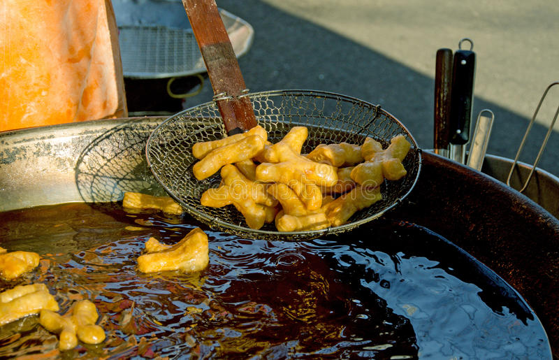 Youtiao, Chinese oil stick. Youtiao, also known as the Chinese Cruller, Chinese oil stick, Chinese Doughnut, and fried breadstick, is a long golden-brown deep royalty free stock image