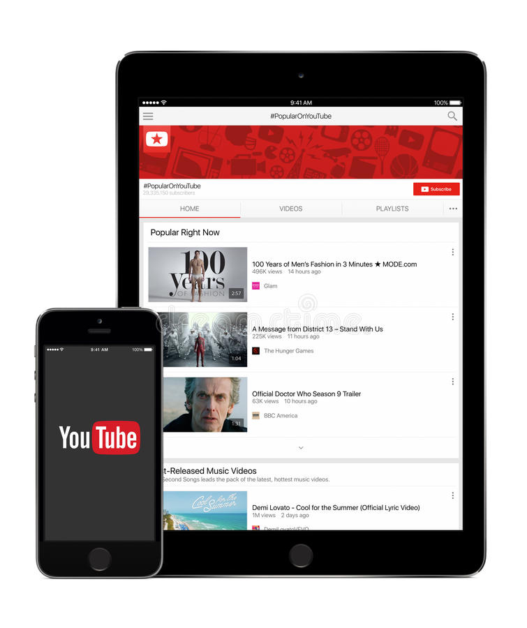 YouTube application on the Apple iPad Air 2 and iPhone 5s display stock photos