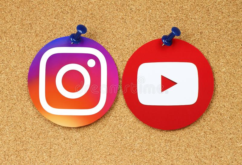 YouTube and Instagram icons pinned on cork bulletin board royalty free stock photo