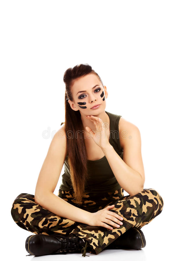 Ypung beautiful soldier woman sitting on the floor.  stock photos