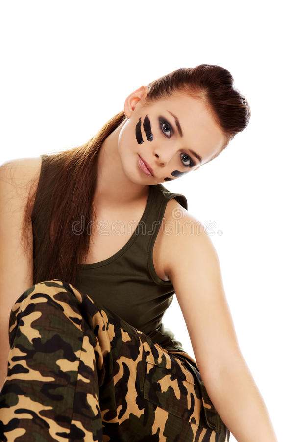 Ypung beautiful soldier woman sitting on the floor.  royalty free stock images