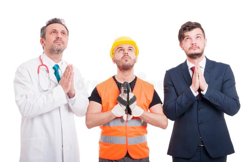 Yrkesmässig byggmästare, advokat och doktor som söker efter hopp royaltyfri foto