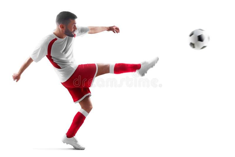 Yrkesmässig fotbollspelare i handling Isolerat i vitbakgrund arkivfoton
