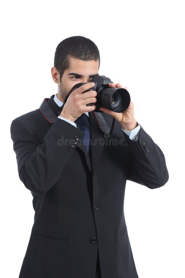 Yrkesmässig fotograf som fotograferar med en digital dslrkamera arkivfoton