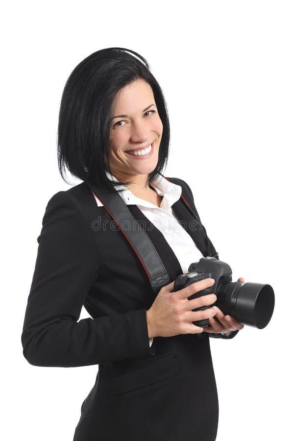 Yrkesmässig fotografkvinna som rymmer en dslrkamera arkivbilder
