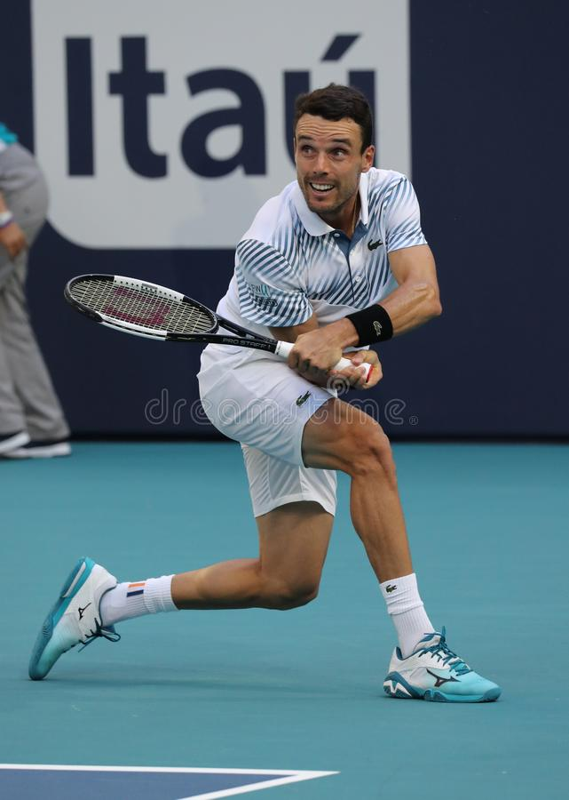 Yrkesmässig tennisspelare Roberto Bautista Agut av Spanien i handling under hans fjärdedel-final match på öppna Miami 2019 arkivbilder