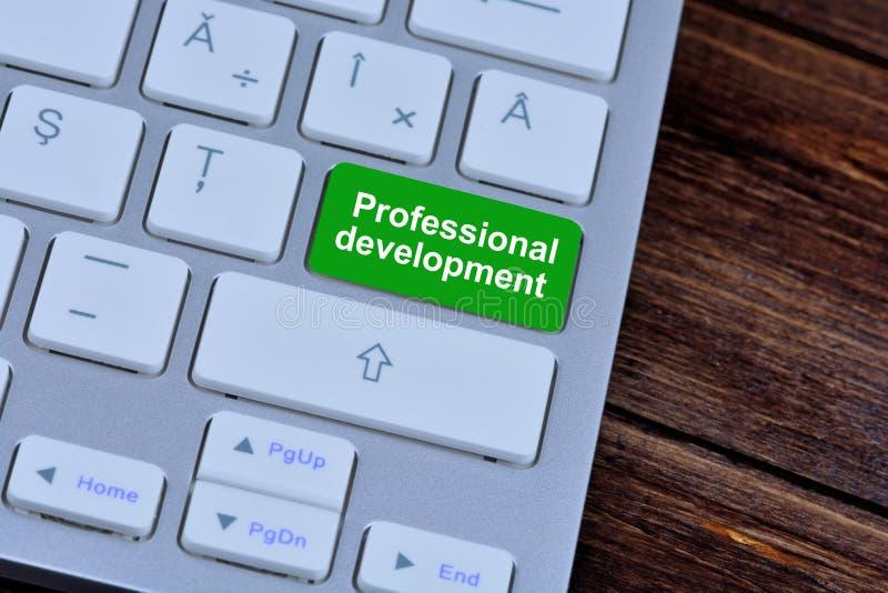Yrkesmässig utveckling på tangentbordknappen royaltyfri foto