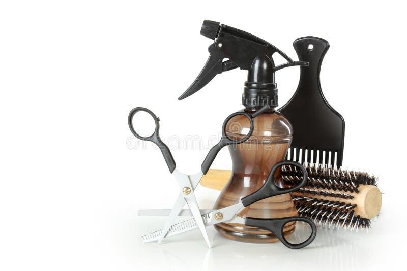 Yrkesmässiga frisörhjälpmedel arkivfoton